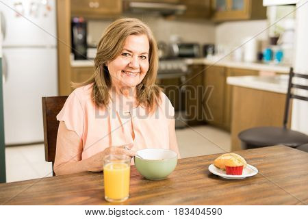 Happy Elder Woman Eating Breakfast