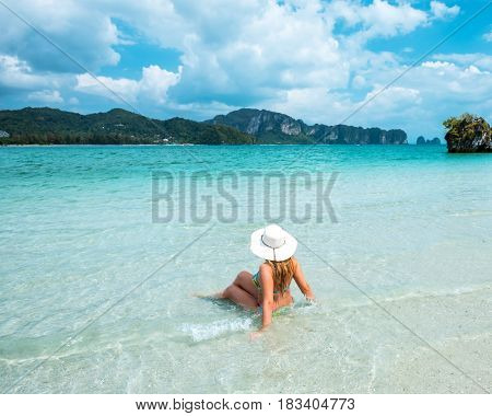 woman in straw hat resting tropical Thailand Ao Nang beach