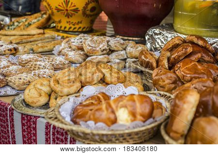 Vibrant food background street showcase with different traditional Ukrainian rolls and pies.