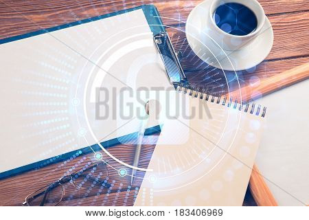 Tablet, coffee cup and other office stuff on wooden table