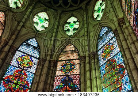 QUITO ECUADOR - DECEMBER 28: Colorful stained glass windows in the Basilica of the National Vow in Quito Ecuador on December 28 2014