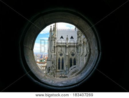 View of the Basilica of the National Vow in Quito Ecuador as seen from a small round window