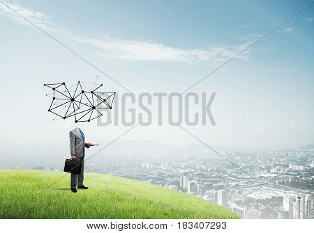 Headless businessman with social networking concept instead of head