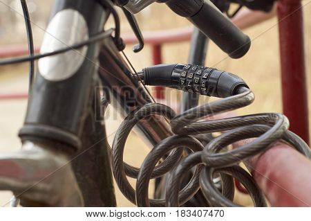 Close up of the combination security lock blocking bicycle in the street