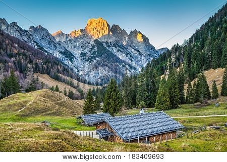 Beautiful Landscape In The Alps With Traditional Mountain Chalets And Glowing Summits In Beautiful E