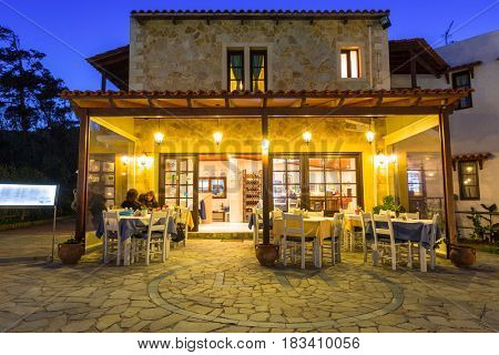 MALEME,GREECE - APRIL 2, 2017: Architecture of Ledra Maleme hotel in Maleme town on Crete, Greece. Ledra Maleme is traditional greek hotel with beautiful architecture in Chania region of Crete.