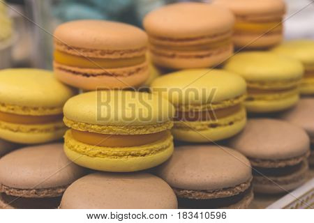 Traditional french colorful macaroons, almond cookies, pastel and vivid colors, toned