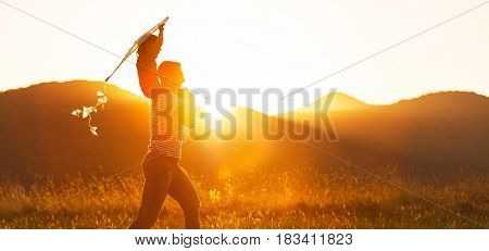 Happy father's day! Child girl and dad with a kite on nature in summer