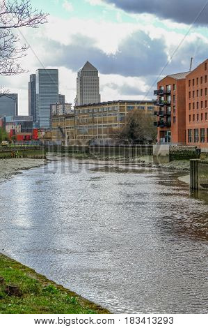 View of River Lea looking towards Canary Wharf from Bow at low tide.