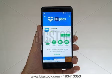 Paris, France, april 22, 2017: Dropbox application on google play store on smartphone