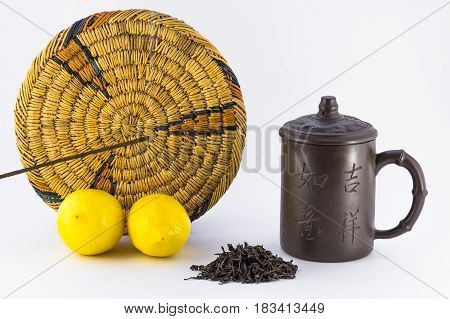 Two lemons and objects for tea ceremony isolated on white background.