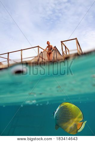 woman on the stairs at descent to the sea and a under water view person is visible through water drops