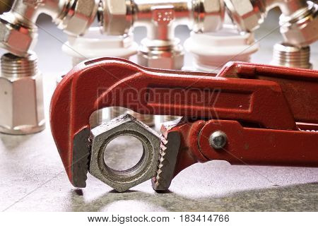 water fittings and adjustable spanner . Still-life