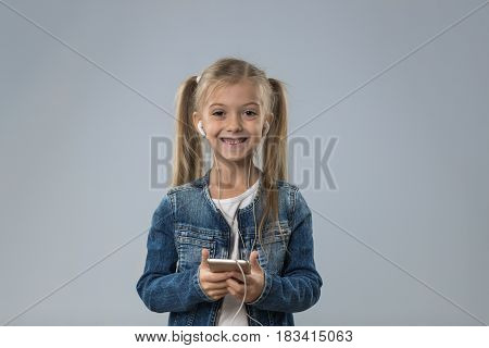 Little Teenage Girl Using Cell Smart Phone, Small Happy Smiling Child Wear Headphones Isolated Over Gray Background