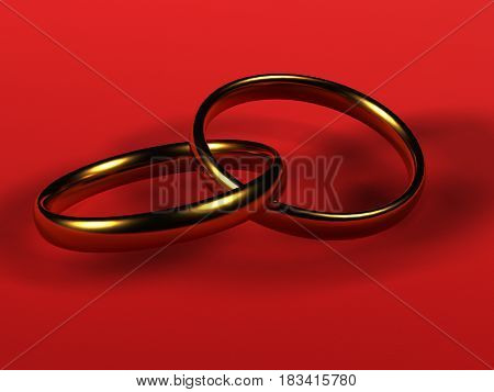 Two gold wedding rings objects close-up red background