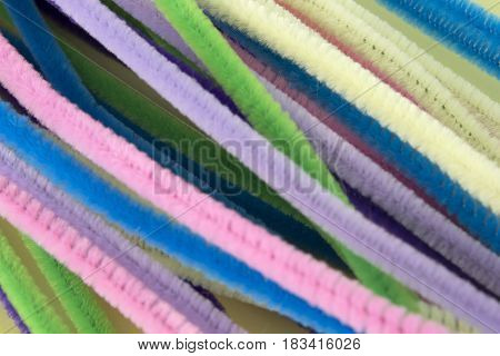 This is a photograph of Pastel colored pipe cleaners