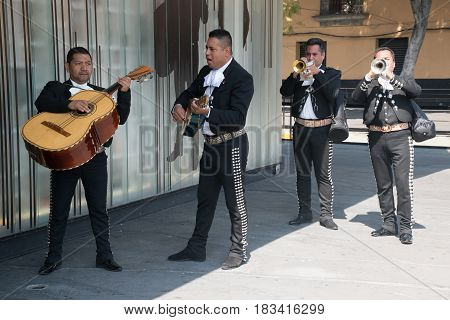 Mexico City, circa february 2017: Mariachi playing on instruments on Plaza Garibaldi in Mexico City