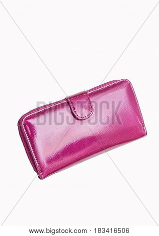 Pink purse. Glossy purse on a white background