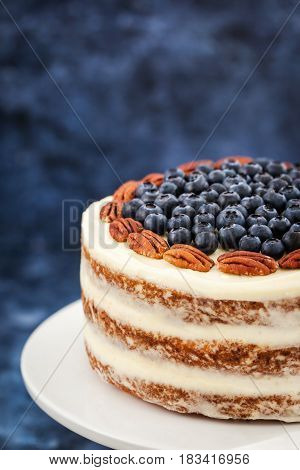 Naked Carrot Cake Decorated With Fresh Blueberry And Pecan