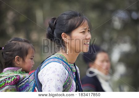 Sa Pa, Vietnam - 15 March, 2017: Ethnic minority, Flower Hmong woman selling goods in the marke in Sapa, Vietnam