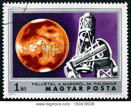 HUNGARY - CIRCA 1974: a stamp printed in Hungary shows Mars and Mt. Palomar Observatory Exploration of Mars circa 1974