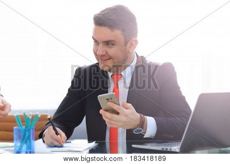 Business man working at the office on laptop