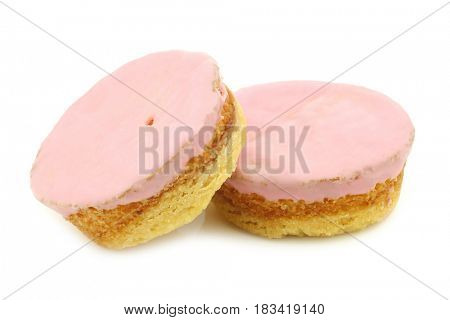Traditional Dutch pink glazed cakes on a white background