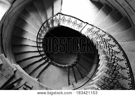 Looking down the middle of a spiral staircase