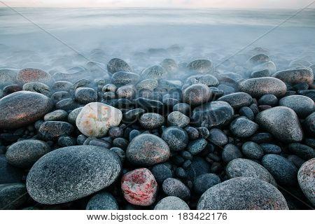 Rock Stones At Ocean Coast At Long Exposure