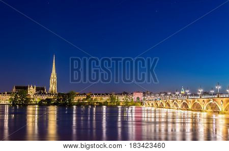Pont de Pierre bridge and Saint Michel Basilica in Bordeaux - France, Gironde
