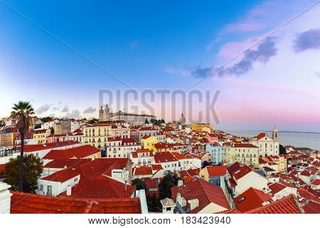 Panoramic view of Alfama, the oldest district of the Old Town, with Monastery of Sao Vicente de Fora, Church of Saint Stephen and National Pantheon dat sunset, Lisbon, Portugal