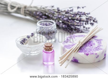 body cream with lavender herbs cosmetic set on white table background