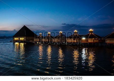 Semporna,Sabah-Apr 21,2017:View of Floating Resort during blue hour sunset at Semporna,Sabah.Semporna is a gateway for diving & snorkeling trips to the islands of Sipadan,Mabul,Mataking,Maiga & others