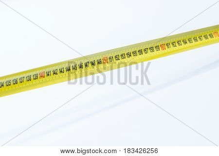 Part Of A Tape Measure Focus On The 150 Centimeter Cm Isolated On White Background