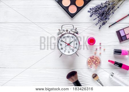 cosmetics composition with alarm clock and lavender flowers on white woman desk background top view mockup
