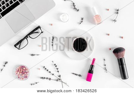 cosmetics composition with glasses and laptop flowers on white woman desk background top view