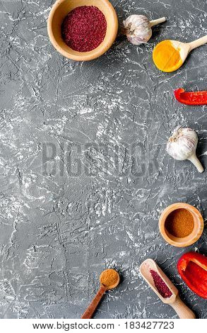 Professional cook workplace with kitchen tools and garlic and spices on gray table background top view mock up