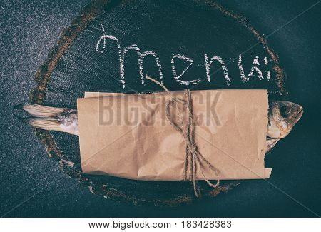 Fish ram is wrapped in brown kraft paper and tied with a rope top view
