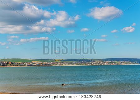 Ocean view with hills green vegetation background and beautiful blue ocean tile view