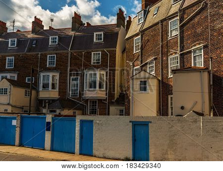 Typical English buildings red brick buildings tall wall and blue doors urban architecture
