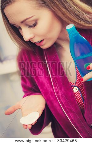 Woman Applying Tonic On Cotton Pad