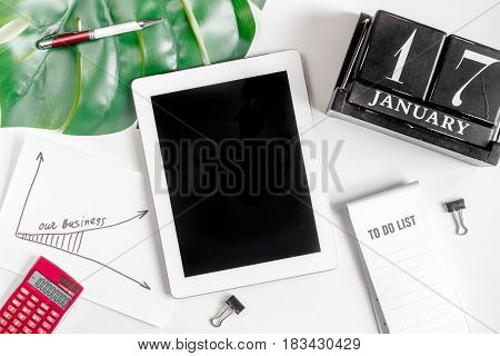 company strategy development management with tablet, calendar and graphic in business set on white office desk background top view mockup