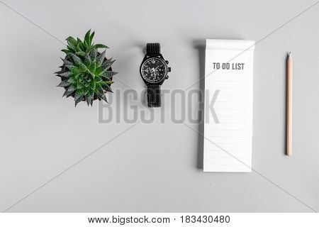 business plan with to do list and watch in management set on gray office table background top view mockup