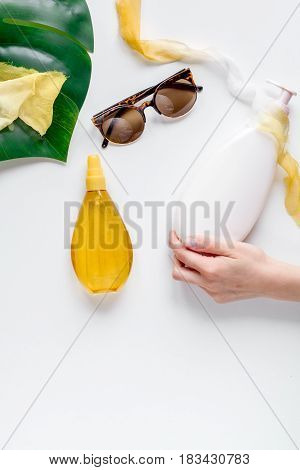 Summer cosmetic set for woman with protection cream and lotion on white background top view mockup