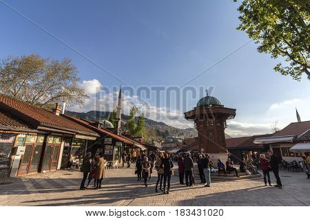 SARAJEVO BOSNIA HERZEGOVINA - APRIL 17 2017: Sebilj fountain on Bacarsija district in the afternoon. This fountain is considered to be one of the greatest landmarks of the Ottoman oart of Sarajevo