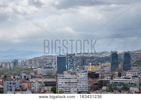 SARAJEVO BOSNIA HERZEGOVINA - APRIL 17 2017: Picture of the newer part of Sarajevo seen from an elevated point of view during a rainy afternoon