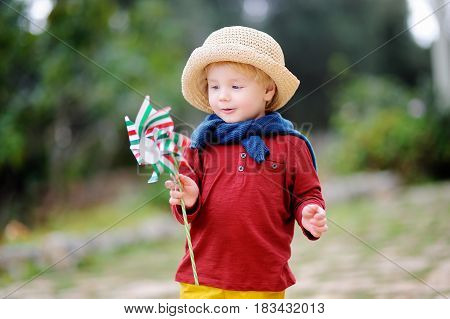 Cute Little Child Holding Toy Windmill With Italian Flag