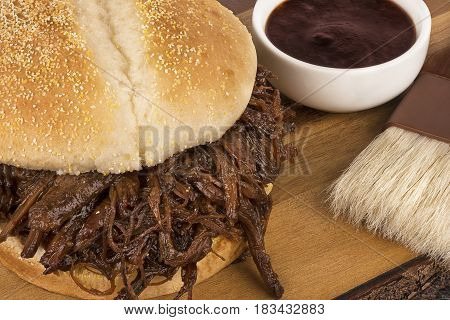 Close up on pulled pork sandwich and barbecue sauce