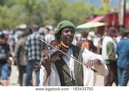 Participant Wearing Vintage Clothes, Playing Violin