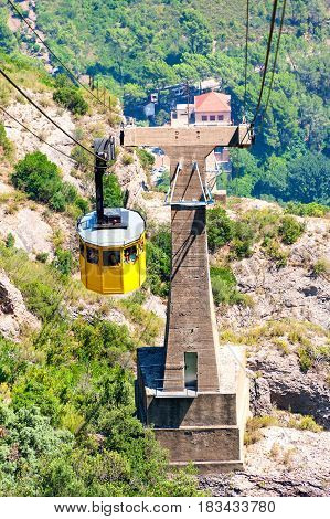 Monserrat Mountain, Spain - August 7, 2014: Cable car is taking visitors to the Monserrat Abbey.